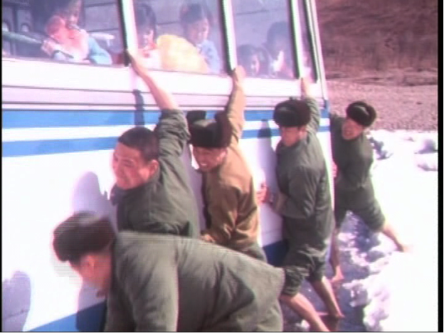 Demobilised soldiers freeing the bus from the icy river in 'The Last Military Salute'