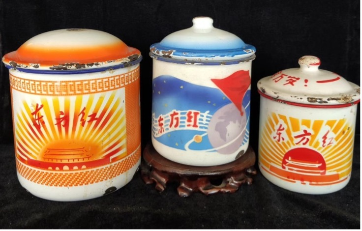 Enamel mugs with Chinese writing saying dongfang hong (the East is red)